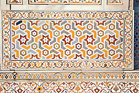 """Agra, India.  Pietra Dura Inlaid Stone Design, Itimad-ud-Dawlah, Mausoleum of Mirza Ghiyas Beg.  The tomb is sometimes referred to as the """"Baby Taj.""""   It is one of the finest examples of pietra dura work, making designs through the use of inlaid colored stone."""