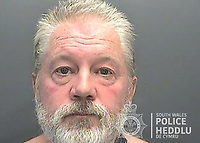 Pictured: Custody picture of Paul Griffiths.<br /> Re: Paul Griffiths, who pointed an imitation firearm at a kebab shop owner – after he was told to wait outside the shop because he refused to wear a mask – has been jailed by Magistrates in Merthyr Tydfil, Wales, UK.<br /> Paul Griffiths, 57, walked into the Rhondda Takeaway on November 5 and tried to order food. <br /> But when asked to put on a mask he refused, so was told to wait outside.<br /> As the owner tried to explain why he was asking him to put on a mask, Griffiths pulled an imitation firearm from his pocket before pointing it at people inside the shop.