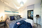 """© Joel Goodman - 07973 332324 - all rights reserved . 12/01/2020 . Salford , UK . Master bedroom of the rented flat of Kayne Lewis (25) , which he shares with Chase (the 5 month old Chihuahua) and SOME FISH , in apartment block """"Duet"""" , on Salford Quays in Greater Manchester . Photo credit : Joel Goodman"""