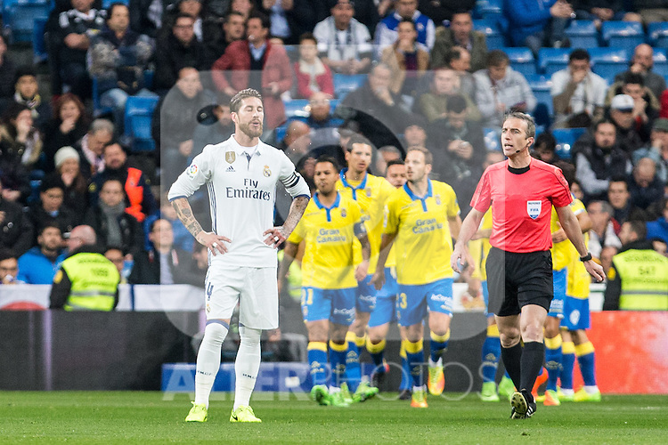 Sergio Ramos of Real Madrid reacts after Pedro Tanausu Tana of UD Las Palmas celebrates after scoring a goal  during the match of Spanish La Liga between Real Madrid and UD Las Palmas at  Santiago Bernabeu Stadium in Madrid, Spain. March 01, 2017. (ALTERPHOTOS / Rodrigo Jimenez)