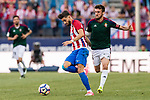 Yannick Ferreira Carrasco of Atletico de Madrid (L) in action against Oier Sanjurjo Mate of Osasuna (R) during the La Liga match between Atletico de Madrid vs Osasuna at the Estadio Vicente Calderon on 15 April 2017 in Madrid, Spain. Photo by Diego Gonzalez Souto / Power Sport Images