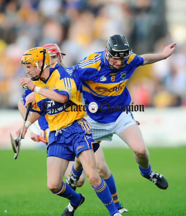 Tipperary's Mark O Meara tackles Clare's Ger Arthur during the Munster U-21 final at Cusack Park. Photograph by John Kelly.