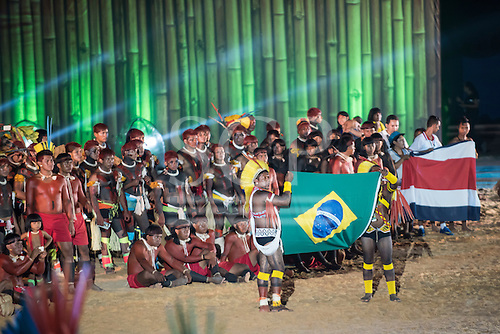 Participants from various ethicities hold the Brazilian national flag and the flag of Costa Rica during the opening ceremony at the first ever International Indigenous Games, in the city of Palmas, Tocantins State, Brazil. Photo © Sue Cunningham, pictures@scphotographic.com 23rd October 2015