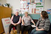 A volunteer driver and a, volunteer advisor at Island Community Action, Easton, Portland, Dorset, with a Dorset POPP Community Development Worker.
