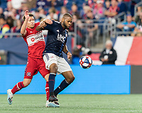 FOXBOROUGH, MA - AUGUST 25: Andrew Farrell #2 of New England Revolution on defense shields the ball, controls, and clears during a game between Chicago Fire and New England Revolution at Gillette Stadium on August 24, 2019 in Foxborough, Massachusetts.