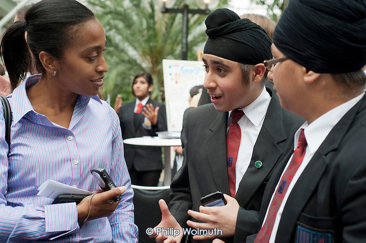 Students from Featherstone High School, in Ealing, London, promote their Oyster on the Go smartphone app at the Apps for Good Awards 2012, the Barbican, London.