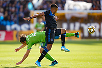 SAN JOSE, CA - SEPTEMBER 30: Gustav Svensson #4 of the Seattle Sounders FC and Danny Hoesen #9 of the San Jose Earthquakes during a Major League Soccer (MLS) match between the San Jose Earthquakes and the Seattle Sounders on September 30, 2019 at Avaya Stadium in San Jose, California.