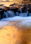 Reflections on small Escalante River, Utah, USA