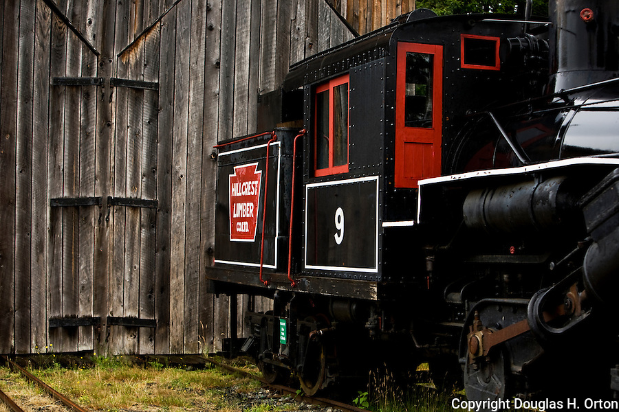 Steam engine on static display outside train barn at the BC Forest Center in Duncan, British Columbia gives tours of the center, which includes an indoor museum and outdoor exhibits of logging equipment, towns, and railroads.