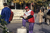 Belgrade, Serbia. Man in red and white coat and red cap selling Blic newspaper on the street.