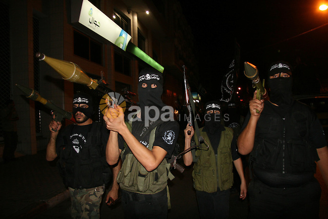 Palestinian militants of the Nasser Salah al-Din Brigades military wing of the Popular Resistance Committees take part in an annual march to mark the creation of their group in Gaza City.