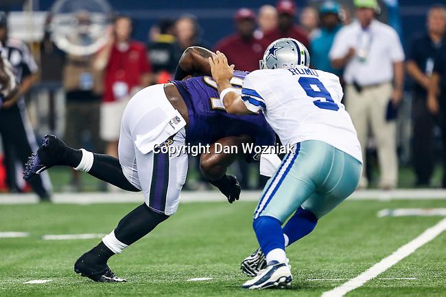 Dallas Cowboys quarterback Tony Romo (9) and Baltimore Ravens outside linebacker Courtney Upshaw (91) in action during the pre-season game between the Baltimore Ravens and the Dallas Cowboys at the AT & T stadium in Arlington, Texas. Baltimore defeats Dallas  37-30.