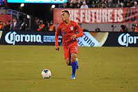 EAST RUTHERFORD, NJ - SEPTEMBER 6: Sergino Dest #18 of the United States kicks the ball during a game between Mexico and USMNT at MetLife Stadium on September 6, 2019 in East Rutherford, New Jersey.