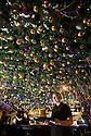 """30/11/15<br /> <br /> Waitress, Alice Marchington, 18.<br /> <br /> It has taken a team of five, two weeks to put up this stunning display of Christmas decorations in what is believed to be one of Britain's most festive pubs. The race was on to put up the 7,500 baubles and 27,000 fairy lights, before guests arrived for the pub's first Christmas parties held last night. <br /> <br /> Each of the five rooms at the Hanging Gate at Chapel-en-le-Frith in the Derbyshire Peak District has a different theme or colour. This year the main restaurant is the Indoor Igloo, the bar area is purple and gold and there's the Candy Cain room upstairs in the pub near Buxton. There's also has another 10,000 lights on the outside of the building. <br /> <br /> """"We've had to replace a few thousand of the LED lights this year, I buy them in huge lengths so it's cost lots  to get everything ready"""" said landlord Mark Thomas.<br /> <br /> All Rights Reserved: F Stop Press Ltd. +44(0)1335 418365   www.fstoppress.com."""