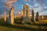 Calanais Standing Stones central stone, at sunset,  circle erected between 2900-2600BC measuring 11 metres wide. At the centre of the ring stands a huge monolith stone 4.8 metres high weighing about 7 tonnes, which is perfectly orientated so that its widest sides face due north south. Calanais Neolithic Standing Stone (Tursachan Chalanais) , Isle of Lewis, Outer Hebrides, Scotland.