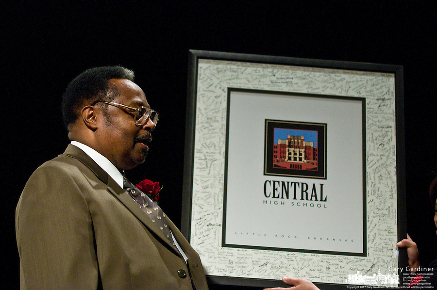 Jefferson Thomas, one of the Little Rock Nine, stands with the framed photo of Central High School in Little Rock signed by its students after delivering the keynote address at the 2009 Westerville, Ohio, MLK Day Celebration. Photo Copyright Gary Gardiner. Not be used without written permission detailing exact usage.