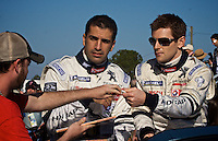 Drivers of the pole-sitting Peugeot Marc Gene, left, and Anthony Davidson sign autographs before the 12 Hours of Sebring, Sebring, FL, MArch 20, 2010.  (Photo by Brian Cleary/www.bcpix.com)