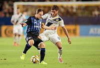 CARSON, CA - SEPTEMBER 21: Samuel Piette #6 of Montreal Impact and Jonathan dos Santos #8 of the Los Angeles Galaxy chase after a ball during a game between Montreal Impact and Los Angeles Galaxy at Dignity Health Sports Park on September 21, 2019 in Carson, California.