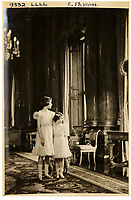 BNPS.co.uk (01202 558833)<br /> Pic: MarcusAdams/ChiswickAuctions/BNPS<br /> <br /> 1939 - The Royal sisters at Buckingham Palace on the eve of WW2 - (Princess Elizabeth aged 13)<br /> <br /> Charming childhood photos of Princess Elizabeth and Princess Margaret have come to light, including a previously unseen image of the future Queen in a kilt.<br /> <br /> The portraits, taken by acclaimed British society photographer Marcus Adams, capture the future Queen from being a baby to her adolescence.<br /> <br /> The Queen Mother would often take her daughters to his central London studio where he would set up toys and props to keep them entertained