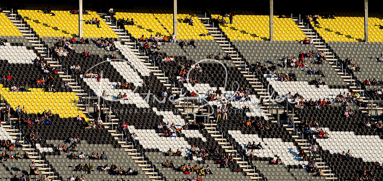 Fans sit in the stands before the Bank of America 500 NASCAR race at Lowes's Motor Speedway in Concord, NC.