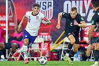 5th September 2021; Nashville, TN, USA;  United States forward Christian Pulisic dribbles the ball past Canada defender Kamal Miller during a CONCACAF World Cup qualifying match between the United States and Canada on September 5, 2021 at Nissan Stadium in Nashville, TN.