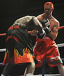 Hari Miles ( Red with Black stripe ) V Nick Okoth (Black flame shorts), Joe Calzaghe Promotions Boxing Evening .Date: Friday 20/11/2009,  .© Ian Cook IJC Photography, 07599826381, iancook@ijcphotography.co.uk,  www.ijcphotography.co.uk, .