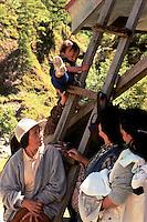 Toddler climbing ladder. Natubleng, Benguet, Philippines. 23 May 1999