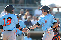 Joe Weik #15 of the Inland Empire 66ers is greeted by teammate Wade Hinkle #16 after hitting a home run during a game against the Lancaster JetHawks at The Hanger on May 26, 2014 in Lancaster, California. Lancaster defeated Inland Empire, 6-5. (Larry Goren/Four Seam Images)