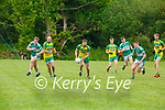 Ronan Collins Gneeveguilla bursts past Seamus Giles and Gary O'Sullivan left Listry during their League game in Listry on Sunday
