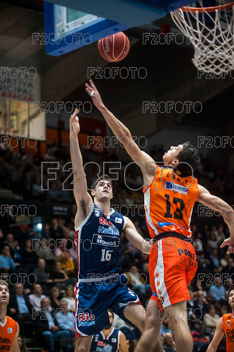 VALENCIA, SPAIN - OCTOBER 31: Lucic and Santiago Yusta during ENDESA LEAGUE match between Valencia Basket Club and Rio Natura Monbus Obradoiro at Fonteta Stadium on   October 31, 2015 in Valencia, Spain