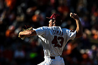 Pitcher Hayden Lehman (43) of the South Carolina Gamecocks delivers a pitch into the fading light in the Reedy River Rivalry game against the Clemson Tigers on Saturday, March 2, 2019, at Fluor Field at the West End in Greenville, South Carolina. Clemson won, 11-5. (Tom Priddy/Four Seam Images)