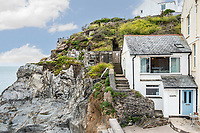 BNPS.co.uk (01202) 558833.<br /> Pic: MarchandPetit/BNPS<br /> <br /> Pictured: The cottage.<br /> <br /> A cute cottage cut into the cliffside with spectacular views along a three-mile stretch of beach is on the market for £500,000.<br /> <br /> Unlike most coastal properties in the area, Boathouse Cottage does not look out to sea but along the popular beach.<br /> <br /> The quirky holiday home is in the picturesque village of Torcross, Devon, right next to Slapton Sands.