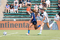 CARY, NC - SEPTEMBER 12: Jessica McDonald #14 of the NC Courage attacks the ball while Kelli Hubly #20 of the Portland Thorns gives chase during a game between Portland Thorns FC and North Carolina Courage at Sahlen's Stadium at WakeMed Soccer Park on September 12, 2021 in Cary, North Carolina.