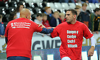 """(L-R) Jonjo Shelvey and Angel Rangel of Swansea warm up wearing a """"Show Racism A Red Card"""" before the Barclays Premier League match between Swansea City and Stoke City played at the Liberty Stadium, Swansea on October 19th 2015"""