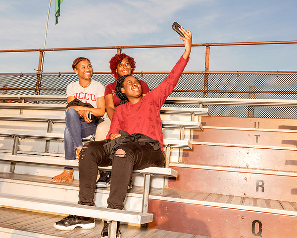 September 21, 2017. Durham, North Carolina.<br /> <br /> (left to right) Dasjah Mitchell, Jessica Fennell and Tamara Chamblee take a photo as they wait for the game to begin. <br /> <br /> The NCCU Eagles won a home game against the the South Carolina State Bulldogs 33-28 at O'Kelly–Riddick Stadium.