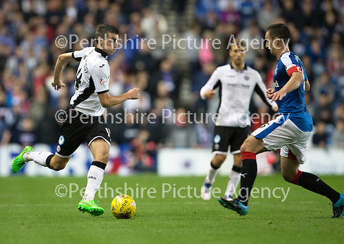 Rangers v St Johnstone...22.09.15  Scottish League Cup Round 3, Ibrox Stadium<br /> Joe Shaughnessy is closed down by Lee Wallace<br /> Picture by Graeme Hart.<br /> Copyright Perthshire Picture Agency<br /> Tel: 01738 623350  Mobile: 07990 594431