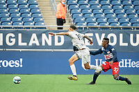 FOXBOROUGH, MA - APRIL 17: Hernan Gonzalez #19 of Richmond Kickers breaks from a tackle by Luis Caicedo #27 of New England Revolution II during a game between Richmond Kickers and Revolution II at Gillette Stadium on April 17, 2021 in Foxborough, Massachusetts.
