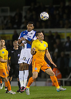 Cristian Montano of Bristol Rovers and Matt Bloomfield of Wycombe Wanderers go up for the ball during the Johnstone's Paint Trophy match between Bristol Rovers and Wycombe Wanderers at the Memorial Stadium, Bristol, England on 6 October 2015. Photo by Andy Rowland.