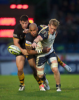 Jake Abbott of Worcester Warriors (right) loses the ball as he is tackled by Tom Lindsay (left) and Tom Varndell of London Wasps during the LV= Cup second round match between London Wasps and Worcester Warriors at Adams Park on Sunday 18th November 2012 (Photo by Rob Munro)