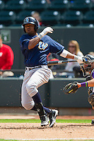 Geulin Beltre (29) of the Wilmington Blue Rocks follows through on his swing against the Winston-Salem Dash at BB&T Ballpark on April 21, 2013 in Winston-Salem, North Carolina.  The Blue Rocks defeated the Dash 5-3.  (Brian Westerholt/Four Seam Images)