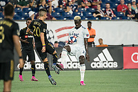 FOXBOROUGH, MA - AUGUST 4: Wilfried Zahibo #23 of New England Revolution and Eduard Atuesta #20 of Los Angeles FC compete for the ball during a game between Los Angeles FC and New England Revolution at Gillette Stadium on August 3, 2019 in Foxborough, Massachusetts.
