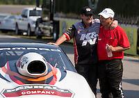 Aug. 18, 2013; Brainerd, MN, USA: V. Gaines (right) congratulates NHRA pro stock driver Mike Edwards after Edwards won the Lucas Oil Nationals at Brainerd International Raceway. Mandatory Credit: Mark J. Rebilas-
