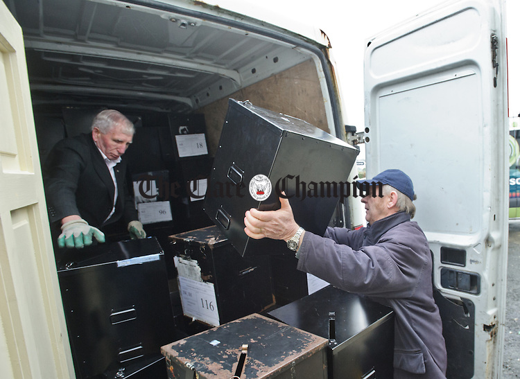 After the boxes are emptied they are taken away at the Clare General Election count in the Falls Hotel, Ennistymon. Photograph by John Kelly.