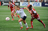 Cat Whitehill (4) of the United States (USA) is chased by Jodi-Ann Robinson (10) of Canada (CAN). The United States (USA) Women's National Team defeated Canada (CAN) 1-0 during an international friendly at Marina Auto Stadium in Rochester, NY, on July 19, 2009.