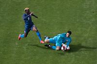 SAN JOSE, CA - Feb 2, 2019:  USA's Gyasi Zardes (9) attempts to run down a ball grabbed by Costa Rica goalkeeper Esteban Alvarado (1) during the USA Men's National Team game against Costa Rica.