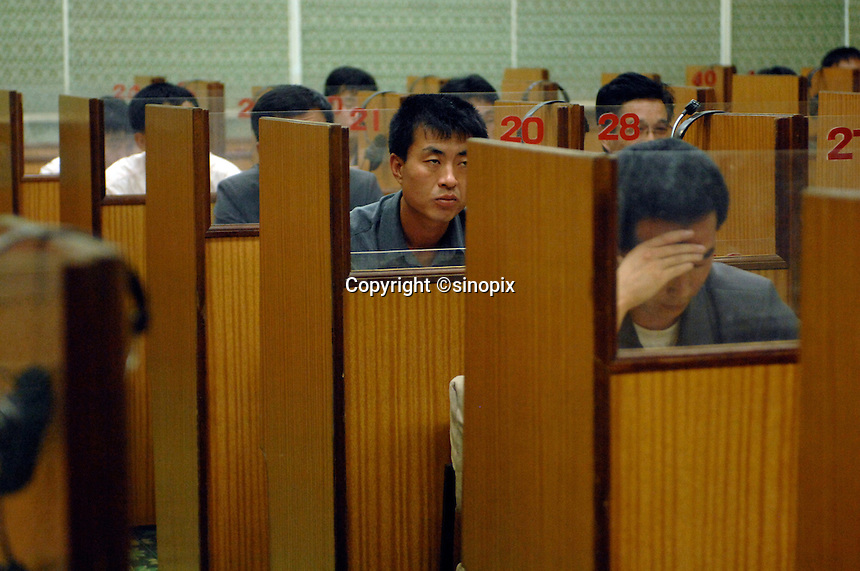"""Students recieve English language lessons in the People's Palace of Education, Pyongyang, North Korea. The """"Palace"""" is the library and place of learning for privileged North Koreans."""