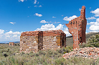 The remains of the Whitington Hotel in Hamilton, Nevada. In 1868 Hamilton started as a boomtown with 25,000 people migrating to the area where silver ore was for the taking. The town was the first county seat of White Pine County, from 1869 to 1887, when a fire led to its replacement by the town of Ely. In 1887 big-scale production ceased and the population left just as quickly as they had come. Today the town is abandoned with only the facades from a few of the buildings remaining. Photo taken July, 2007.