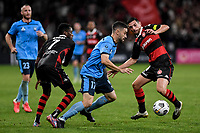 1st May 2021; Bankwest Stadium, Parramatta, New South Wales, Australia; A League Football, Western Sydney Wanderers versus Sydney FC; Anthony Caceres of Sydney goes between Bruce Kamau and Graham Dorrans of Western Sydney Wanderers
