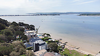 BNPS.co.uk (01202) 558833. <br /> Pic: CorinMesser/BNPS<br /> <br /> Pictured: The development site at Dorset Lake Avenue in Poole, Dorset opens onto Poole Harbour by the Sandbanks Peninsula.<br /> <br /> A wealthy homeowner has made the 'brave' decision to demolish his £6m seaside mansion that has its own indoor pool, gym and cinema. <br /> <br /> Ashley Faull has flattened the 20-year-old luxury house to build nine new flats to meet the increasing demand for housing that has led to a surge in property prices.<br /> <br /> The apartments will be priced between £1.495m to £2.8m.<br /> <br /> The now ruined four-storey and 19-room home sits on a half-an-acre plot that backs on to Poole Harbour and overlooks exclusive Sandbanks in Dorset.