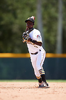 GCL Pirates shortstop Victor Ngoepe (5) throws to first during a game against the GCL Braves on August 10, 2016 at Pirate City in Bradenton, Florida.  GCL Braves defeated the GCL Pirates 5-1.  (Mike Janes/Four Seam Images)